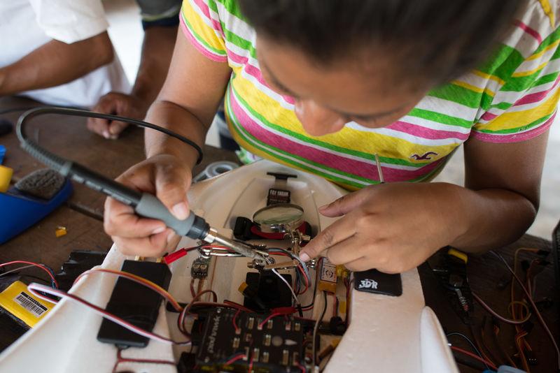 Tessa soldering a drone